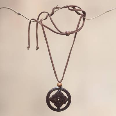 Coconut shell floral necklace, 'Lotus Faith' - Floral Coconut Shell Pendant Necklace