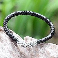 Leather braided bracelet, 'Rattle Snake Tales' - Handcrafted Braided Leather and Sterling Silver Bracelet