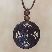 Coconut shell pendant necklace, 'Four Flowers'