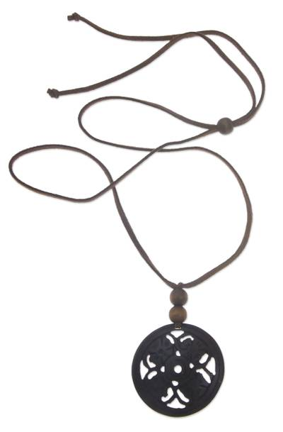 Coconut shell pendant necklace, 'Four Flowers' - Coconut shell pendant necklace