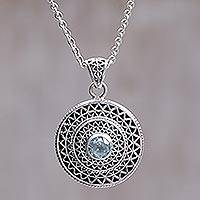 Blue topaz pendant necklace, 'Javanese Sunbeams' - Circular Blue Topaz Pendant Necklace Crafted in Bali