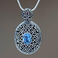 Blue topaz pendant necklace, 'Jakarta Smile' - Blue topaz pendant necklace