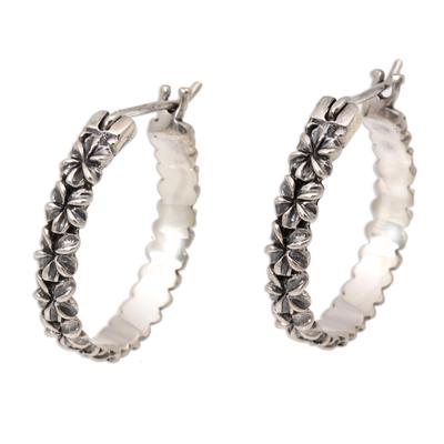 Sterling silver hoop earrings, 'Frangipani Garland' - Artisan Crafted Intricate Floral Silver Hoop Earrings