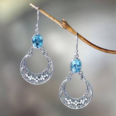 Blue topaz dangle earrings, 'Sumatra Moons' - Unique Sterling Silver and Blue Topaz Dangle Earrings