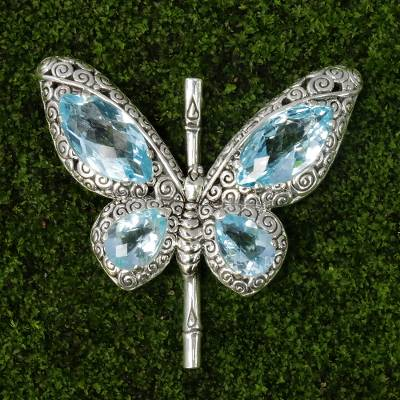 Blue topaz pendant, 'Butterfly of Hope' - Sterling Silver and Blue Topaz Pendant from Indonesia