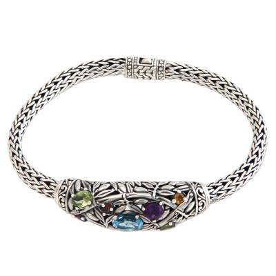Blue topaz and peridot braided bracelet, 'Bamboo Blossoms' - Blue topaz and peridot braided bracelet