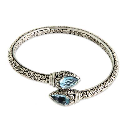 Blue topaz bangle bracelet, 'Tears of Buddha' - Fair Trade Sterling Silver and Blue Topaz Bangle Bracelet