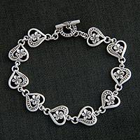 Sterling silver flower bracelet, 'Loyal Love' - Artisan Crafted Sterling Silver Heart Bracelet