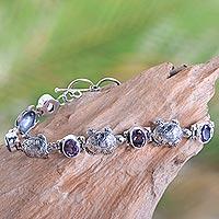 Amethyst link bracelet, 'Turtle Migration' - Balinese Silver Turtle Theme Handcrafted Amethyst Bracelet