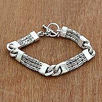 Men's sterling silver braided bracelet, 'Two Halves' - Handcrafted Men's Sterling Silver Link Bracelet