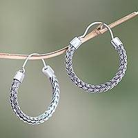 Sterling silver hoop earrings, 'Interwoven' - Hand Crafted Sterling Silver Hoop Earrings