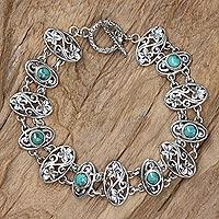 Sterling silver flower bracelet, 'Frangipani Fantasy' - Floral Sterling Silver and Reconstituted Turquoise Bracelet