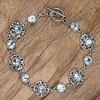 Blue topaz flower bracelet, 'Frangipani Glam' - Floral Sterling Silver and Blue Topaz Link Bracelet