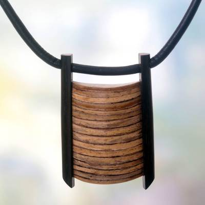 Ebony and coconut shell pendant necklace, 'Whispering Palm' - Ebony and coconut shell pendant necklace
