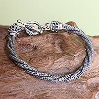 Men's sterling silver bracelet, 'Naga Twist' - Handcrafted Men's Silver Braided Bracelet from Indonesia
