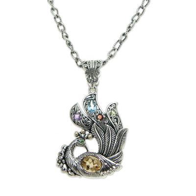 Citrine and blue topaz pendant necklace, 'Javanese Peacock' - Citrine and blue topaz pendant necklace