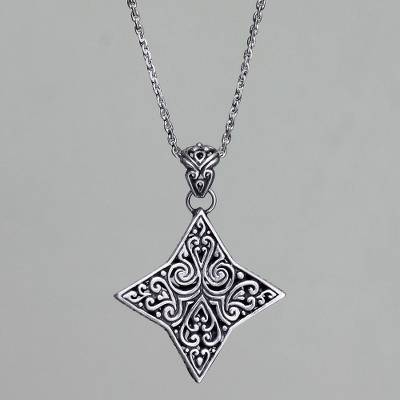 Sterling silver pendant necklace, 'Star of Bali' - Balinese Floral Star Handmade Silver Necklace