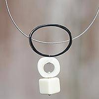 Stainless steel and bone pendant necklace, 'Toraja Amulet' - Handcrafted Necklace with Water Buffalo Horn