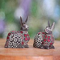 Wood batik sculptures, 'Rabbit Romance' (pair) - Set of Two Wood Batik Rabbit Sculptures
