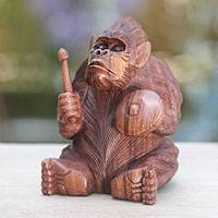 Wood statuette, 'Orangutan Plays the Kempur' - Artisan Crafted Orangutan Wood Statuette