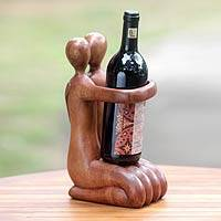 Wood wine bottle holder, 'Gift of Love' - Balinese Hand Carved Romantic Wine Bottle Holder