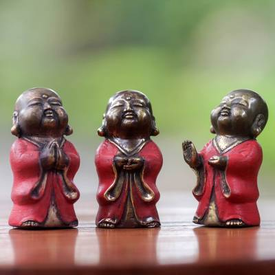 Bronze figurines, 'Little Buddha in Red' (set of 3) - Three Aged Bronze Buddha Images from Bali