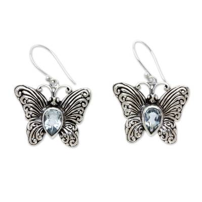 Blue topaz dangle earrings, 'Enchanted Butterfly' - Handcrafted Indonesian Silver and Blue Topaz Earrings