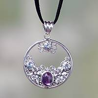 Blue topaz and amethyst pendant necklace, 'Floral Moon' - Amethyst and Blue Topaz Sterling Silver Necklace from Bali