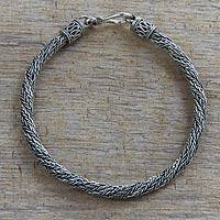 Men's sterling silver braided bracelet, 'Wyvern Mystique' - Men's Hand Made Textured Silver Braided Bracelet