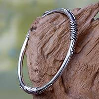 Sterling silver bangle bracelet, 'Balinese Cobras' - Sterling Silver Naga Theme Handcrafted Bangle Bracelet