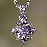 Citrine and amethyst flower necklace, 'Jasmine Shield' - Floral Sterling Silver Necklace with Citrine and Amethyst