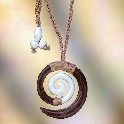 Wood pendant necklace, 'Hypnotic Borneo' - Hand Carved Wood and Bone Macrame Necklace