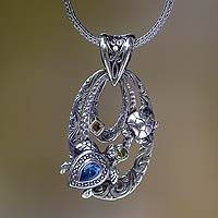 Blue topaz pendant necklace, 'Mother Sea Turtle' - Silver and Blue Topaz Turtle Necklace