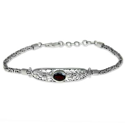 Garnet braided bracelet, 'Different Worlds' - Modern Balinese Garnet Bracelet