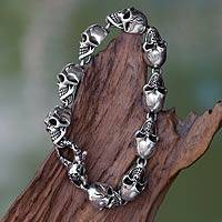 Men's sterling silver link bracelet, 'Trunyan' - Men's Sterling Silver Skull Bracelet from Bali