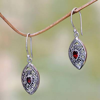 Garnet dangle earrings, 'Karma Shield' - Faceted Garnet and Sterling Silver Earrings from Bali