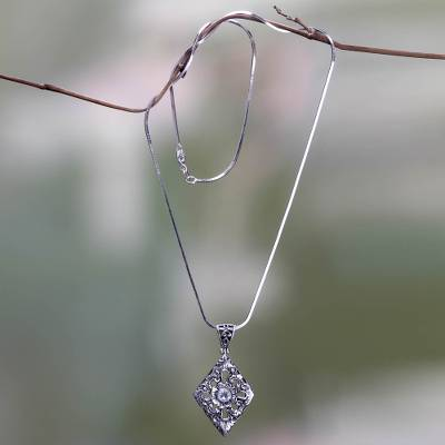 Blue topaz pendant necklace, 'Blue Padma' - Blue Topaz and Sterling Silver Floral Pendant Necklace