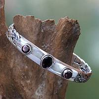 Garnet cuff bracelet, 'Three Guardians' - Braided Sterling Silver Cuff Bracelet with Three Garnets