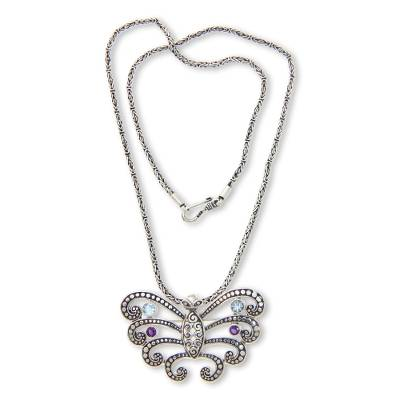 Blue topaz and amethyst necklace, 'Kupu Kupu Barong' - Butterfly Pendant Necklace with Blue Topaz and Amethyst