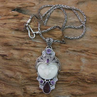 Amethyst and bone pendant necklace, 'Candra Kirana' - Carved Bone and Amethyst Necklace from Bali