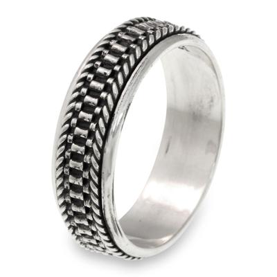 Men's sterling silver meditation spinner ring, 'Odyssey' - Men's Textured Sterling Silver Meditation Ring
