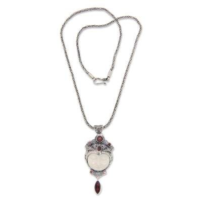 Carved pendant necklace with Garnet, 'Layonsari' - Carved Pendant Necklace with Garnet from Bali