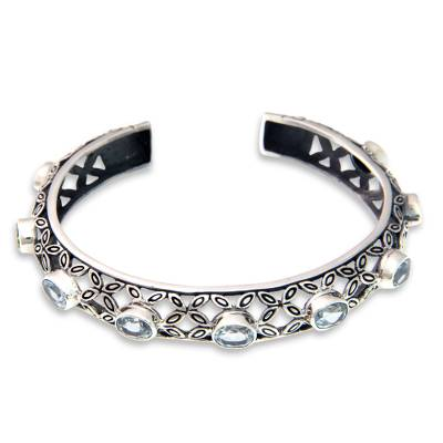 Blue topaz cuff bracelet, 'Java Kawung' - Silver and Blue Topaz Cuff Style Bracelet from Bali