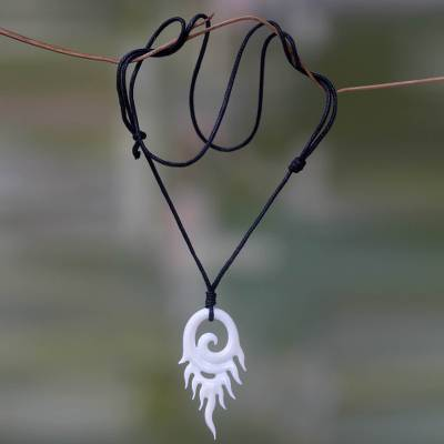 Bone pendant necklace, 'Swirling Flame' - Hand Carved Cow Bone Pendant Necklace from Bali