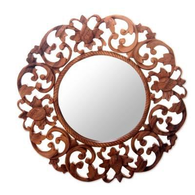 Wood wall mirror, 'Balsamina Buds' - Round Floral Carved Suar Wood Wall Mirror from Bali