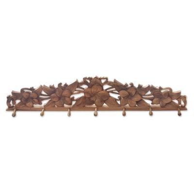 Wood coat rack, 'Frangipani Blossoms' - Fair Trade Wood Coat Rack with Hand Carved Flowers