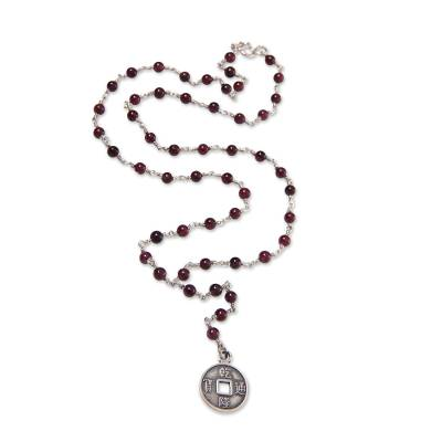 Garnet Y necklace, 'Crimson Pis Bolong' - Garnet and Sterling Silver Necklace with Lucky Coin