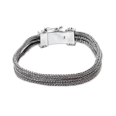 Sterling silver chain bracelet, 'Dragon Tails' - Triple Strand Sterling Silver Naga Chain Bracelet from Bali