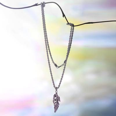 Sterling silver pendant necklace, 'White Feather' - Sterling Silver Feather Pendant Necklace on Rope Chain