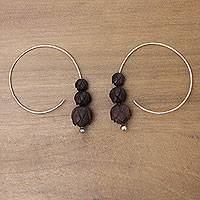Sterling silver and wood hoop earrings, 'Lotus Shadow' - Balinese Sterling Earrings with Hand Carved Wood Flowers
